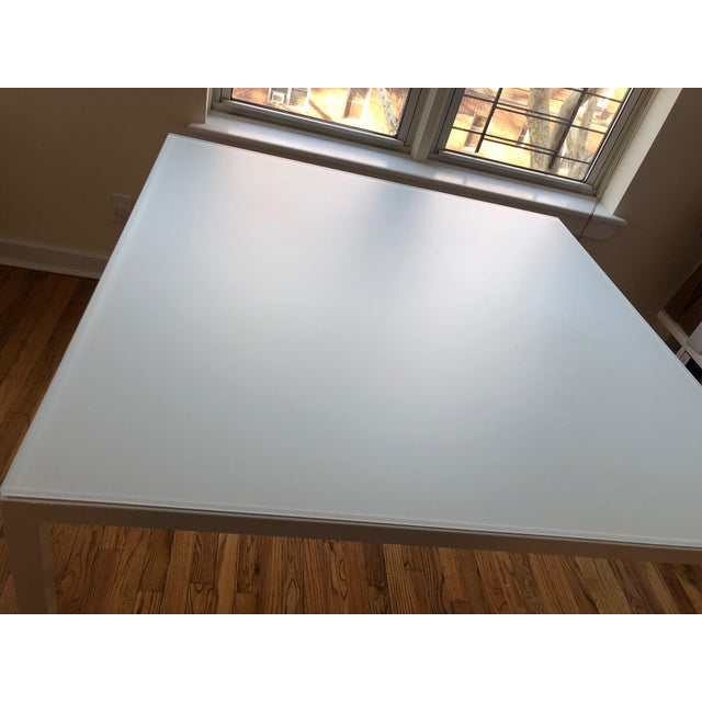 I bought this table from Room + Board two years ago to use as a layout/conference table in my interior design office. I...