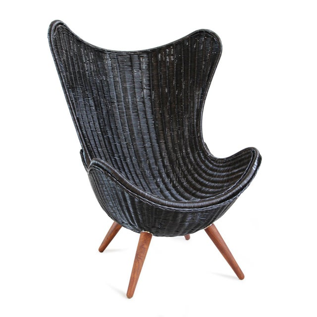 Black stained hand woven wicker egg shaped easy chair. Modern design with classic materials and teak stained wood legs....