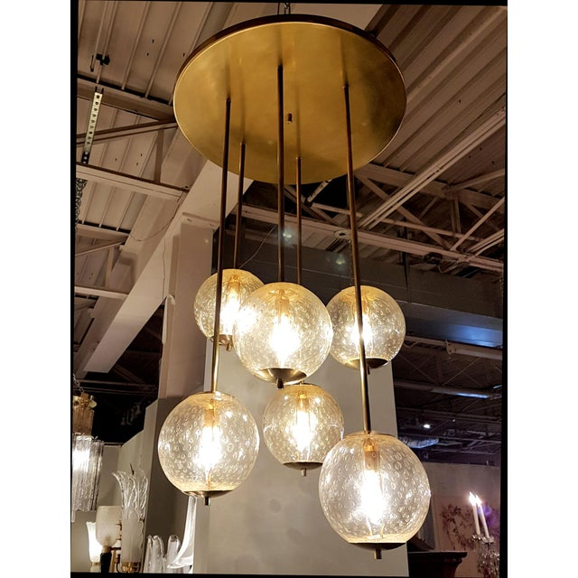 Mid-century modern 6-clear glass globes brass flush mount light, attr to Venini For Sale In Dallas - Image 6 of 6