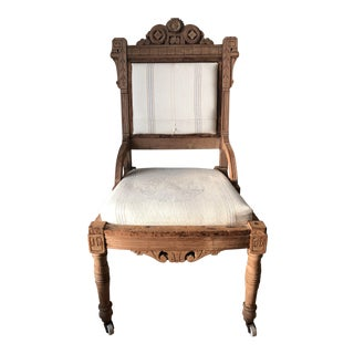 Vintage Carved Wood Reupholstered Chair With Wheels