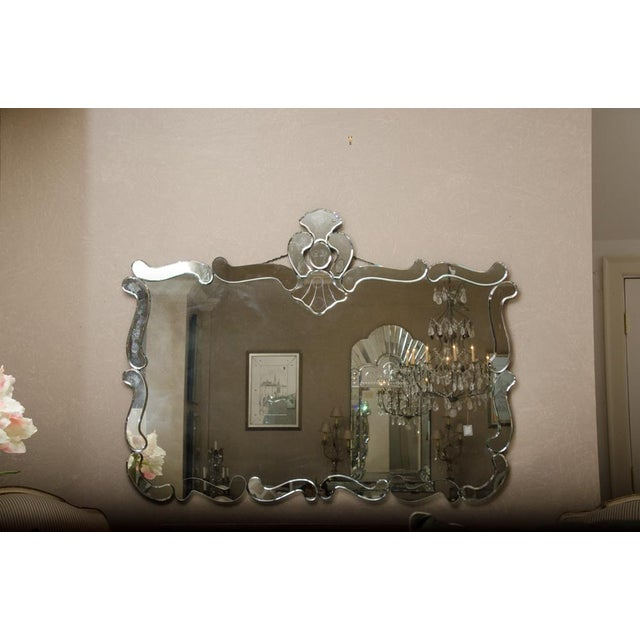 Beautiful horizontal French deco mirror. Three of the curved mirrored pieces have been replaced otherwise in very fine...