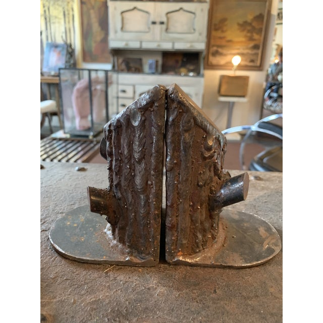 Perfectly patinated cast iron metal bookends.