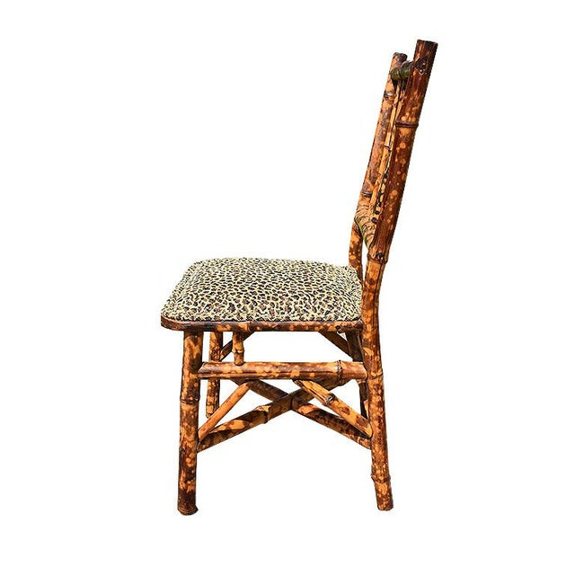 English small children's burnt bamboo (also known as tortoise shell bamboo) chair. This small chair is created from bamboo...