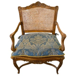 Provincial Louis XV Style Carved Cane Bergère or Office Armchair For Sale