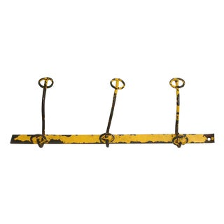 20th Century Industrial Yellow Distressed Hook Wall Rack For Sale