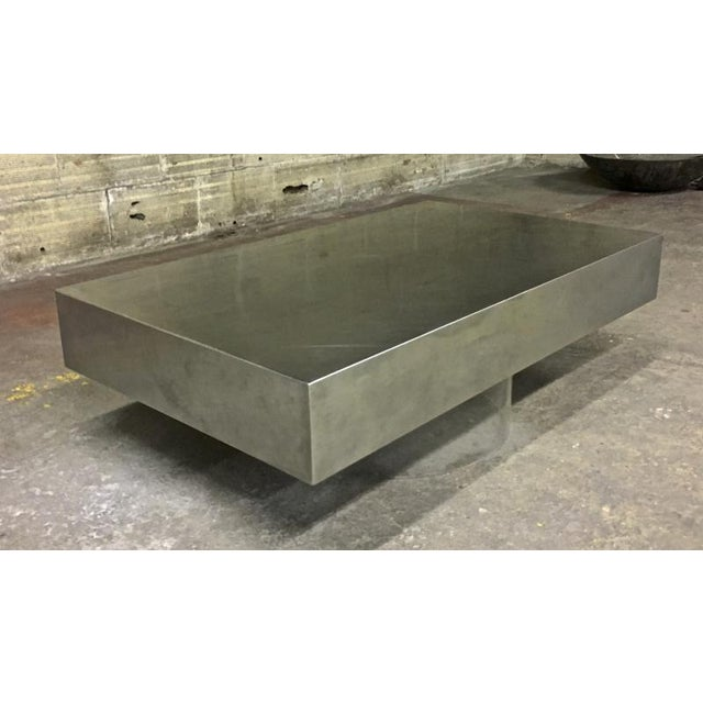 Pure design brushed steel table with lucite lightening base.