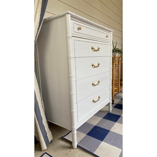 Gorgeous Thomasville tall dresser with faux bamboo and brass accents. Repainted last month in high gloss white lacquer....
