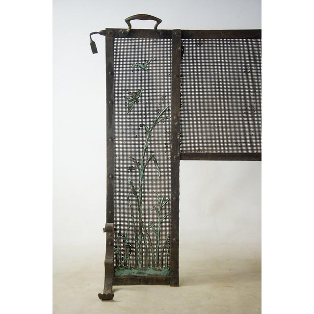 Cozy up next to the fire and have peace of mind with this Italian cast iron fireplace screen. The two side panels are...