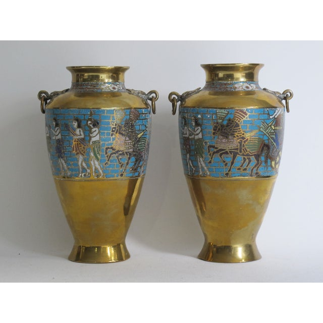 Pair of brass vases with stone inlay in an Egyptian revival style. Marked on the bottom with a sticker from the Chelsea...