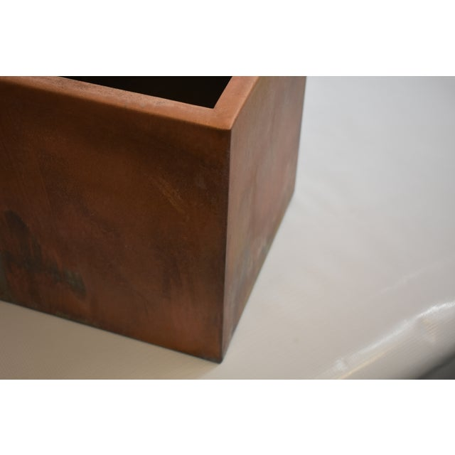 This is a handmade steel box. The piece features a stunning pink patina.