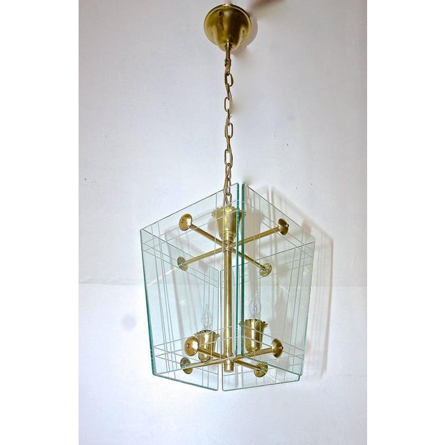 Italian moderne hall or entry pendant light in the manner of Pietro Chiesa for Fontana Arte. Etched glass panels are...
