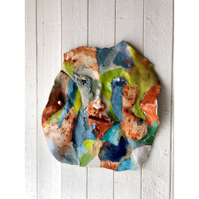 Incredible, artist made (unsigned) large and colorful face abstract clay wall sculpture. Extremely heavy. There is a thick...