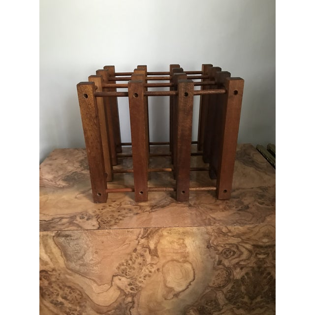 The elegant and simple design of this teak wine rack constructed of wood and dowels is a real stunner. In the style of...