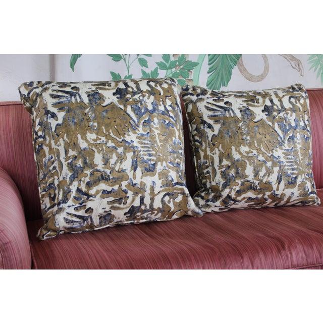 Pair of Modern/contemporary printed linen down pillows has a navy blue and bronze design on almond cream background and...