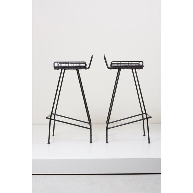 Pair of Tony Paul iron bar stools, 1950s, USA with black leather seat.