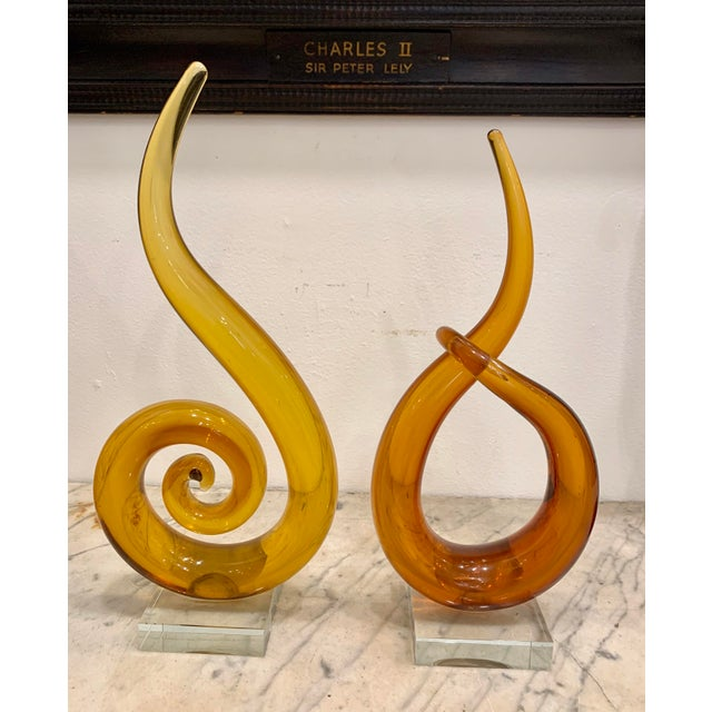Wonderful pair of Venetian Murano glass sculptures in amber glass , one circular spiral with upturned top in light amber ,...