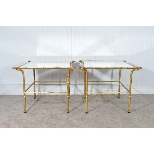 Item: Vintage Italian Hollywood Regency gold gilt faux bamboo side tables with glamorous mirrored tops. Age: Mid 20th...