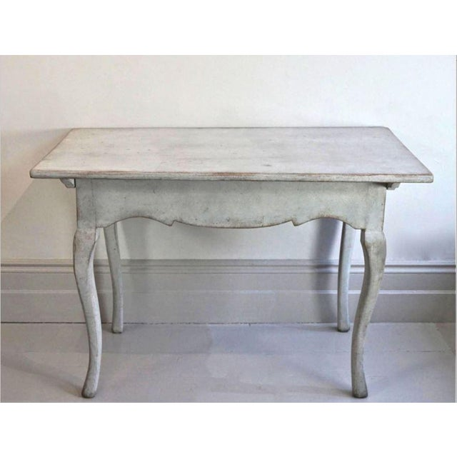 Epoque 18th C Swedish Rococo Side Table with original blue-gray painted finish, carved apron and curved legs.