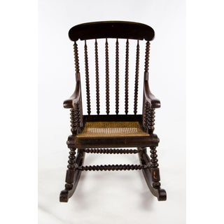 Late 19th Century Vintage Victorian Bobbin Turned and Caned Seat Rocking Chair Preview