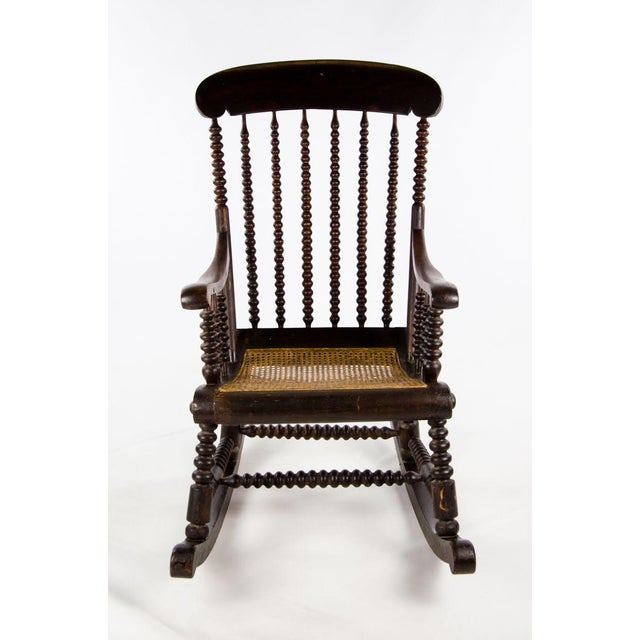 Retire to your new favorite chair after a long day! This stunning Victorian bobbin turned rocking chair offers intricate...
