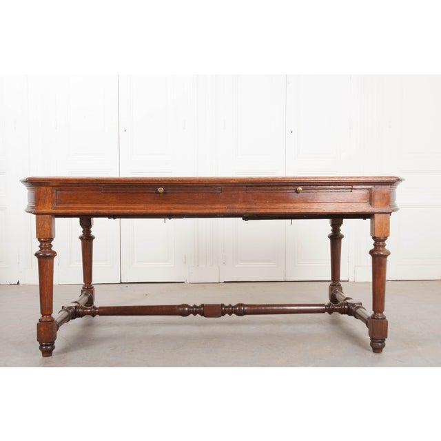 This fantastic oak sewing table is from France, c. 1860. Large enough for two people sitting next to each other, one side...