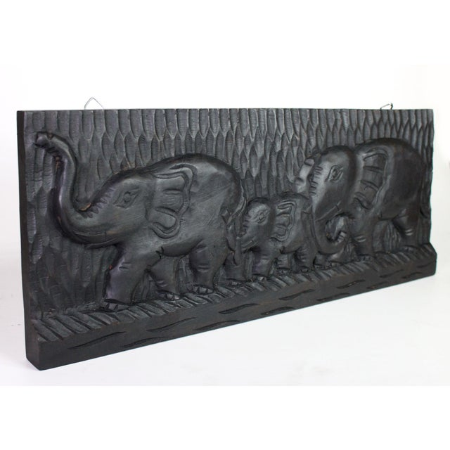 A vintage trio of elephants hand-carved into solid wood transported from Africa to the United States during the mid-...