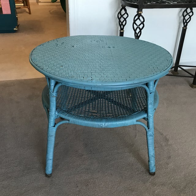 The cutest vintage wicker and rattan table in the most perfect shade of blue! Use as a side table or small coffee table....