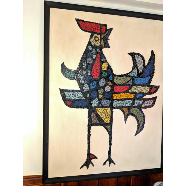Beautiful abstract tile mosaic of a rooster, mounted on painted wooden backing and framed. Colors are bright and...