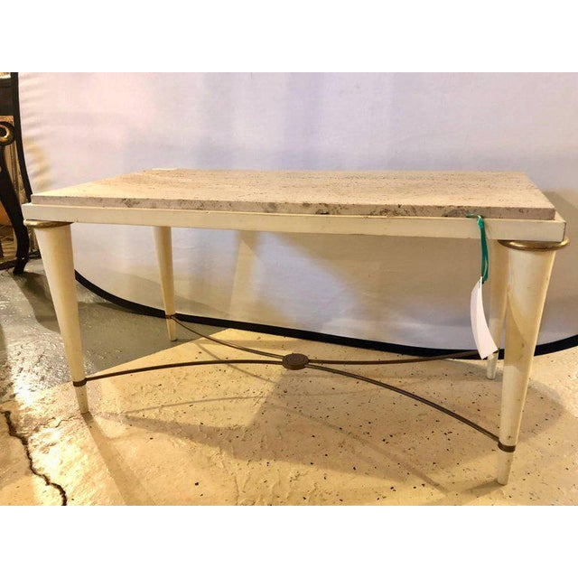Mid-Century Modern coffee table with inset travertine marble top, giltwood and brass X form stretcher, circa 1960.