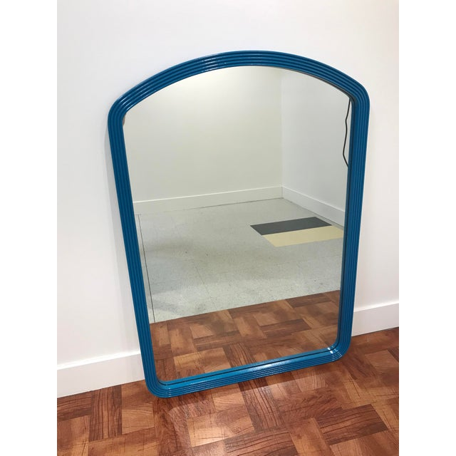 The jewel-tone teal color of this large mirror with its simple ribbed arched frame makes this vintage hotel mirror modern...