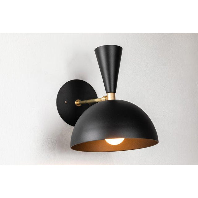 Pair of large 'Lola II' sconces in black. Hand-fabricated by Los Angeles based designer and lighting professional Alvaro...