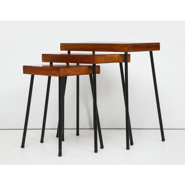 Nest of three tables with birch tops and blackened tubular steel legs. Designed by David Wurster and produced for...
