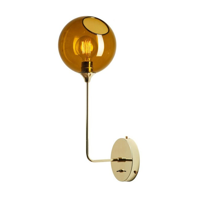 The spherical Ballroom sconces with translucent hues will create a subtle warm glow in your interior. Material: Mouth...