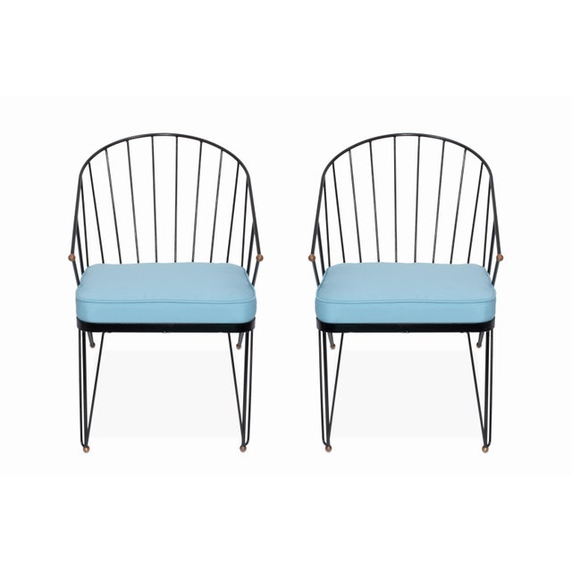 Here is a fantastic pair of mid century patio chairs freshly painted with new Sunbrella cushions. They feature wrought...