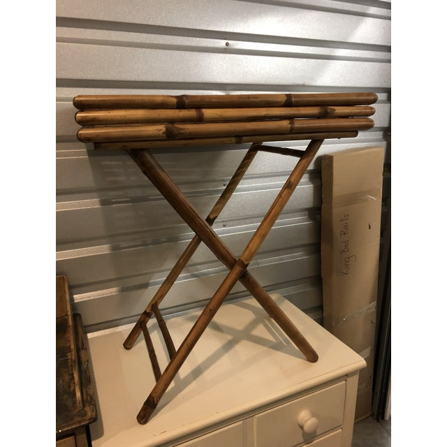Beautiful bamboo butler's tray style table. Would make a wonderful side table or bar. Top does not remove from base. Base...
