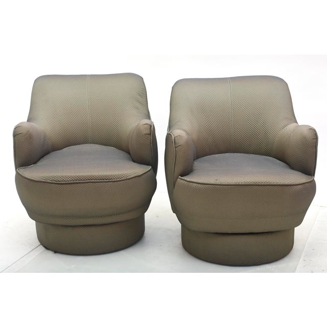 Pair of Barrel Swivel chairs of typical form, in original fabric, in fine working order.