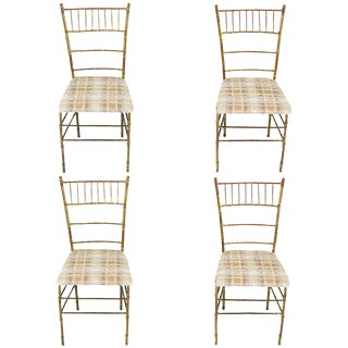 Four Aged Gilt Metal Bamboo Chiavari Style Chairs For Sale