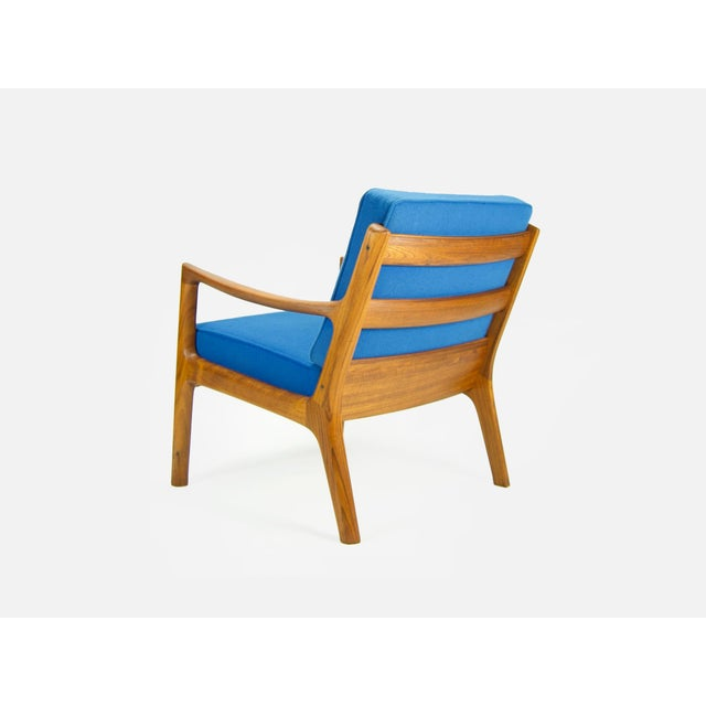 Danish Modern 'Senator' lounge chair designed by Ole Wanscher for France & Son. The chair features a solid teak frame with...