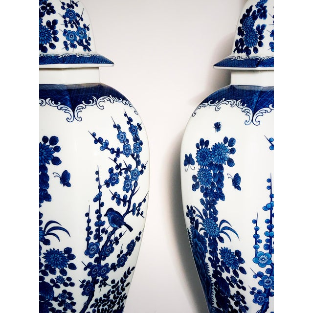 Genuinely Stunning blue and white 1960's ginger jar table lamps by Frederick Cooper, equipped with three-way switches....