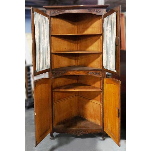 Late 20th Century wooden corner cupboard with four doors and interior shelves.