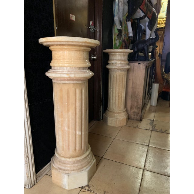 Pair of Tuscany pink marble pedestals, can be used indoors and outdoors. Each column is 5 pieces that come apart for easy...