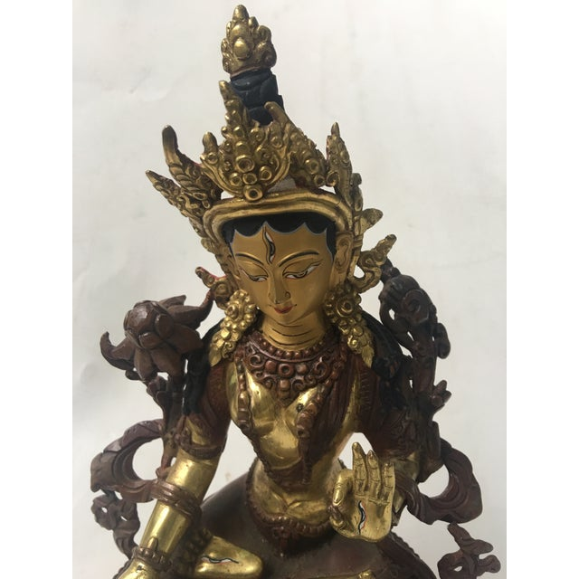 A very beautiful Gold Detailed Tara Buddhist Goddess with gold and enamel like paint finish. Very fine and ornate details....
