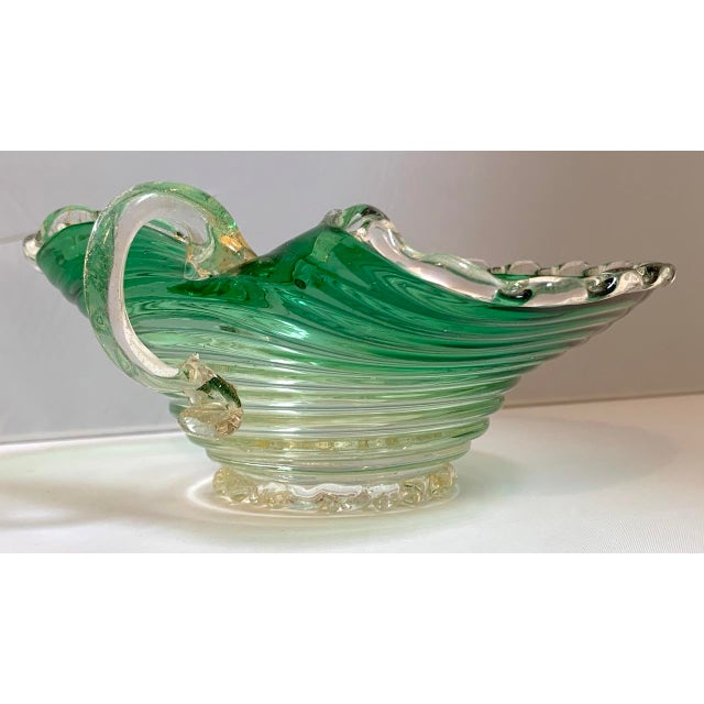 Vintage Italian hand blown glass candy dish featuring a scalloped rim and bottom, gradient green ribbed body and clear...