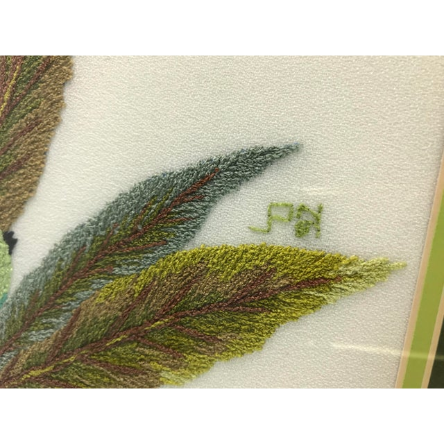 I love this needlepoint art piece. It is handmade and signed by the artist. This piece features a branch of eucalyptus...