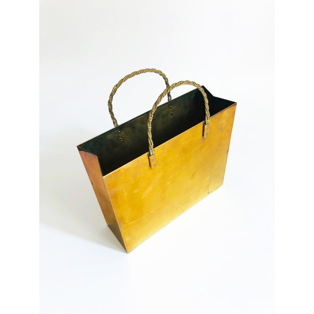 A vintage brass magazine rack, designed in the shape of shopping bag attributed to Italian designer, Gio Ponti. Nice rigid...