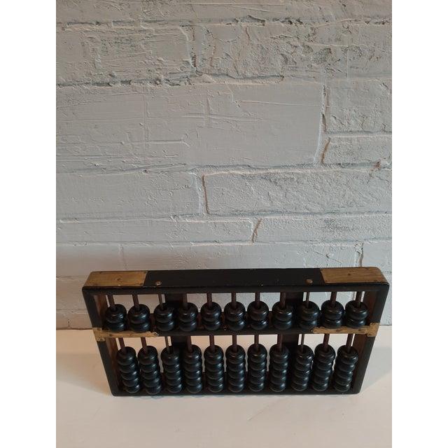Vintage black abacus. Original tag on back. Hong Kong.