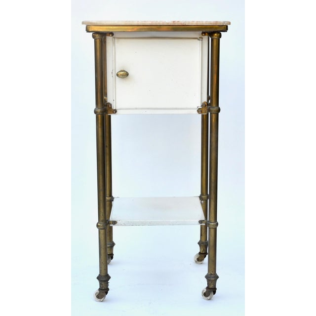 A fabulous antique medical rolling cart with marble top and closed cabinet. I found this in a hip industrial loft and the...