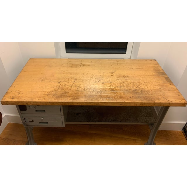 Vintage steel frame workbench/table with 2 steel drawers, solid wood top. Used item with patina, rust and scratches. Lots...