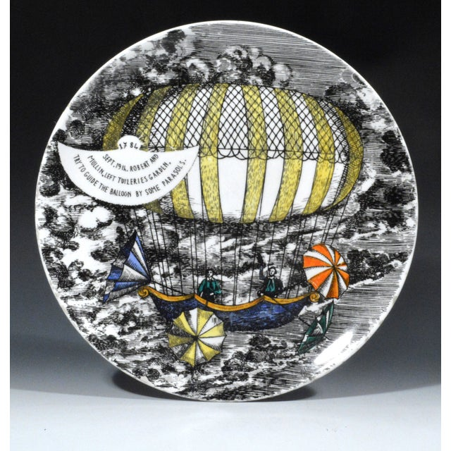Hot air balloons were a Fornasetti favorite. The pattern was known as Mongolfiere. This is number 6 in series and dates...