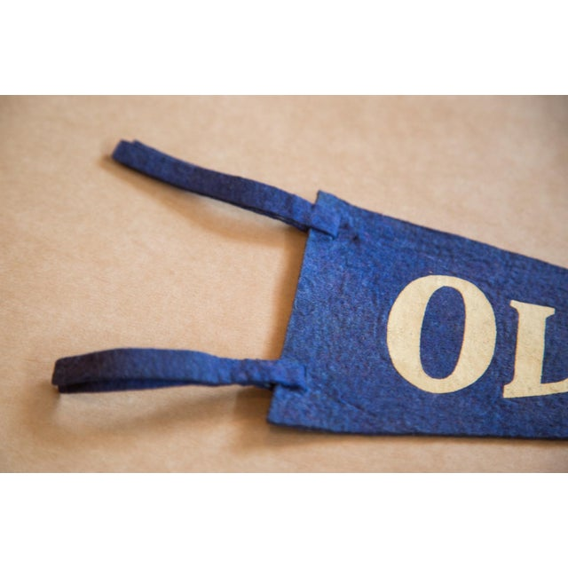 :: Olivera Street, Los Angeles felt flag banner with a charming and simplistic design with the ties slotted into very...